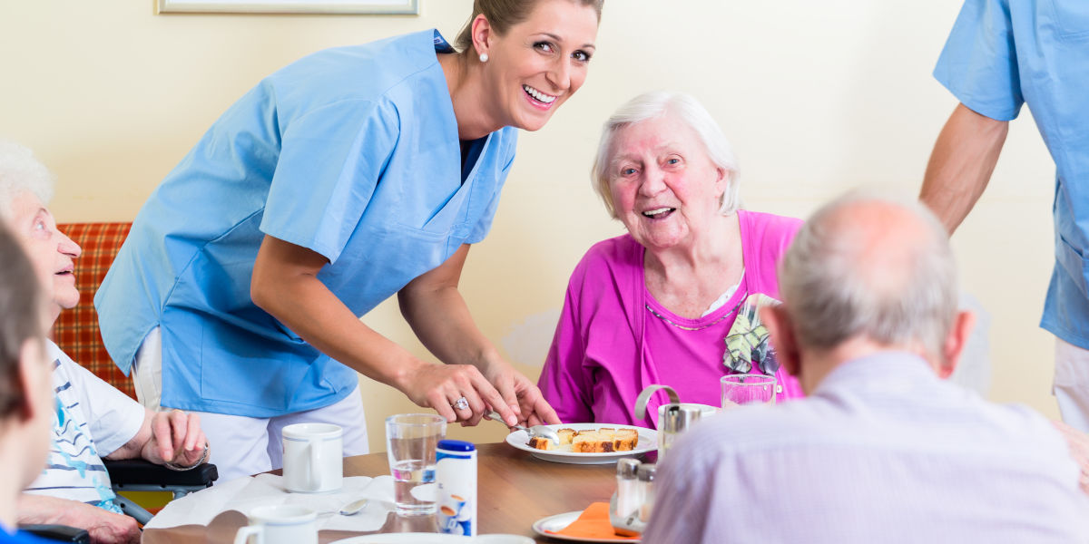 Care worker helping with dining