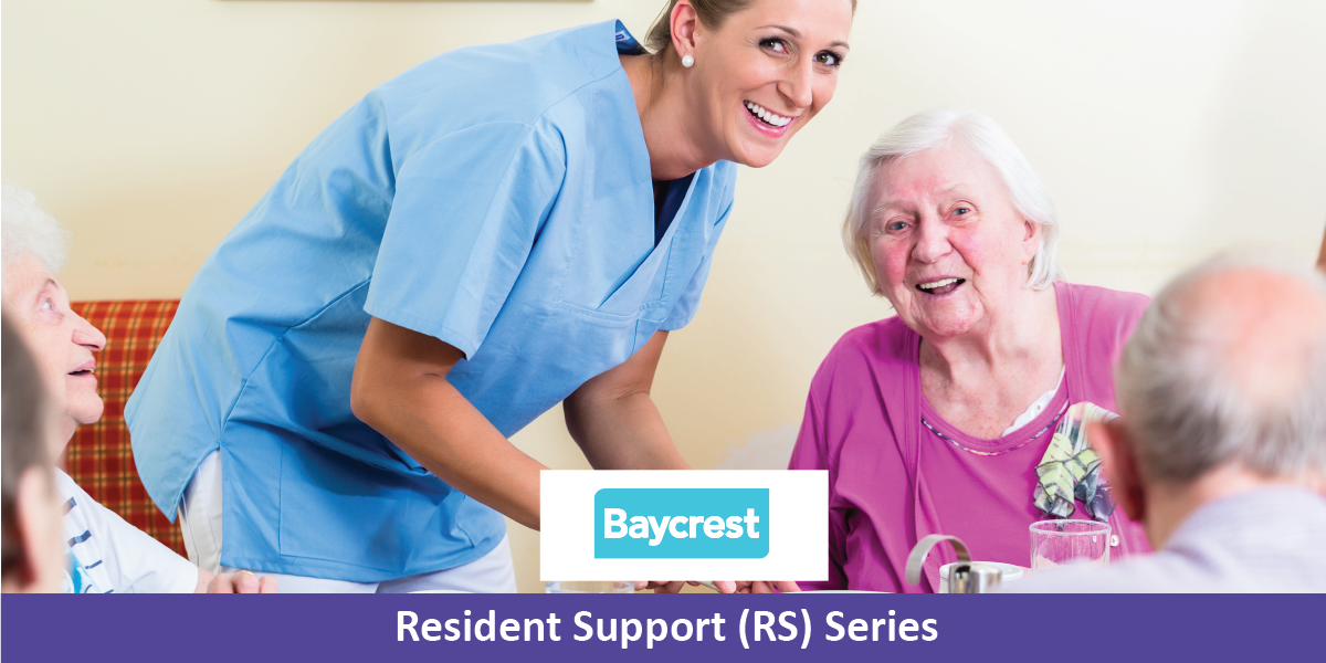 Group of seniors having food in nursing home